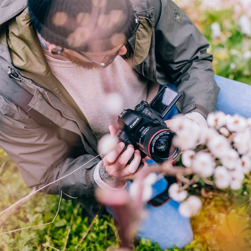 man-taking-a-photo-of-flowers.jpg